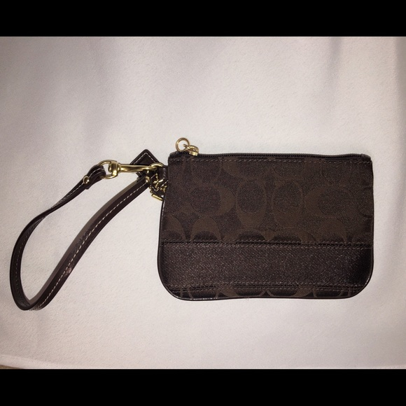 Coach Handbags - Coach brown and gold wristlet, never used